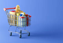 Shopping cart full of food on blue background