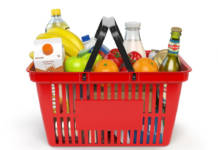 Shopping basket with variety of grocery products isolated on white background. 3d illustration