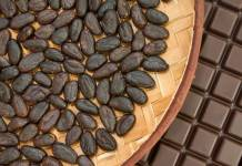 Cocoa beans from Madagascar with chocolate in craft basket