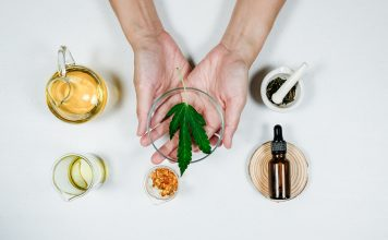 cbd thc oil medical treatment in doctor laboratory. natural medicine on clinical research . top view.