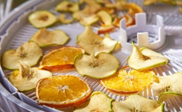 Apple and orange chips cooked in a dehydrator, close-up. The theme of healthy eating