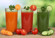 Fresh vegetable juice from carrots, tomatoes and cucumber