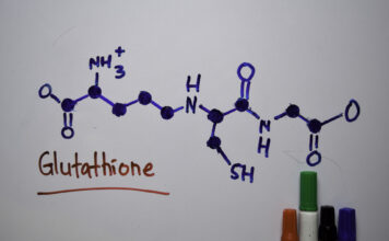 Glutathione molecule written on a white board. Structural chemical formula. Education concept